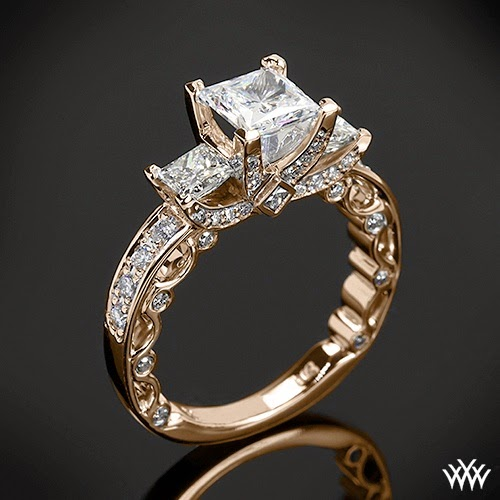 http://www.whiteflash.com/engagement-rings/three-stone/bead-set-princess-3-stone-engagement-ring-by-verragio-1909.htm