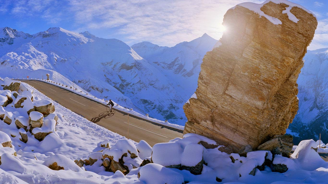 Cyclist on Grossglockner High Alpine Road, Carinthia, Austria (© SIME/eStock Photo) 597