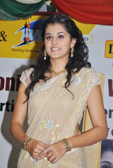 tapsee in saree at tmc electronics hot images