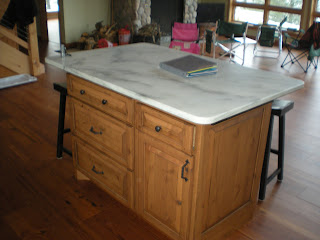 Knotty alder kitchen island, honed marble top, http://huismanconcepts.com/