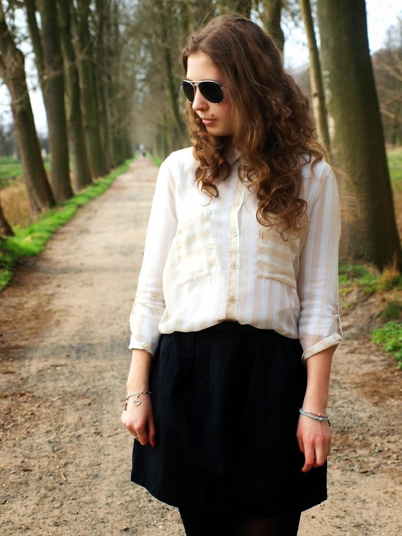 Striped shirt and black skirt
