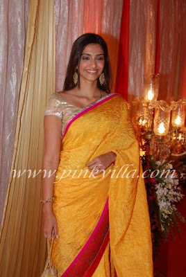 Sonam Kapoor sexy in golden saree
