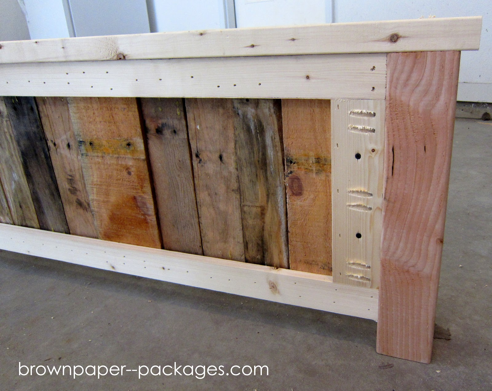 Pallet brown paper packages wood pallet bed for How to make a wood pallet headboard