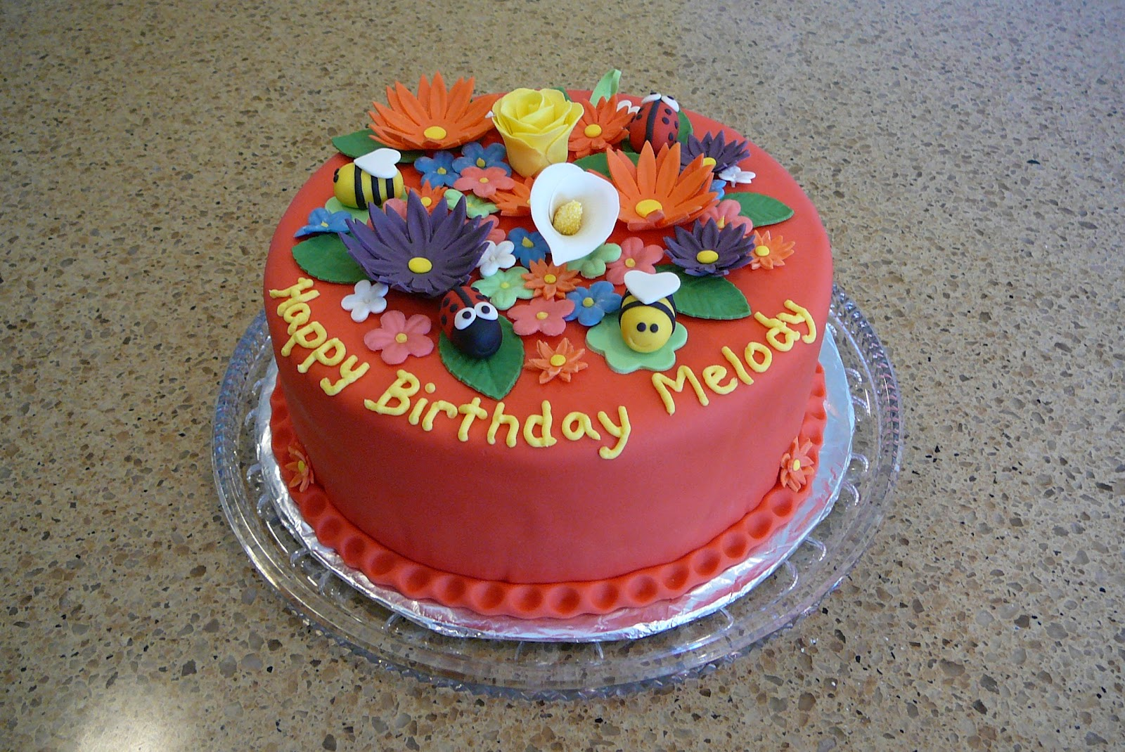 Rise and bake a flower garden cake it was a chocolate cake underneath with a buttercream filling pretty standard stuff melody helped me make the 4 bugs on the cake and we had great fun izmirmasajfo