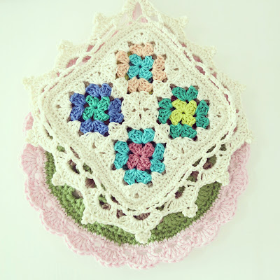 ByHaafner, crochet, potholder, pastel, white, bright, lacy edging, scalloped edging, granny square