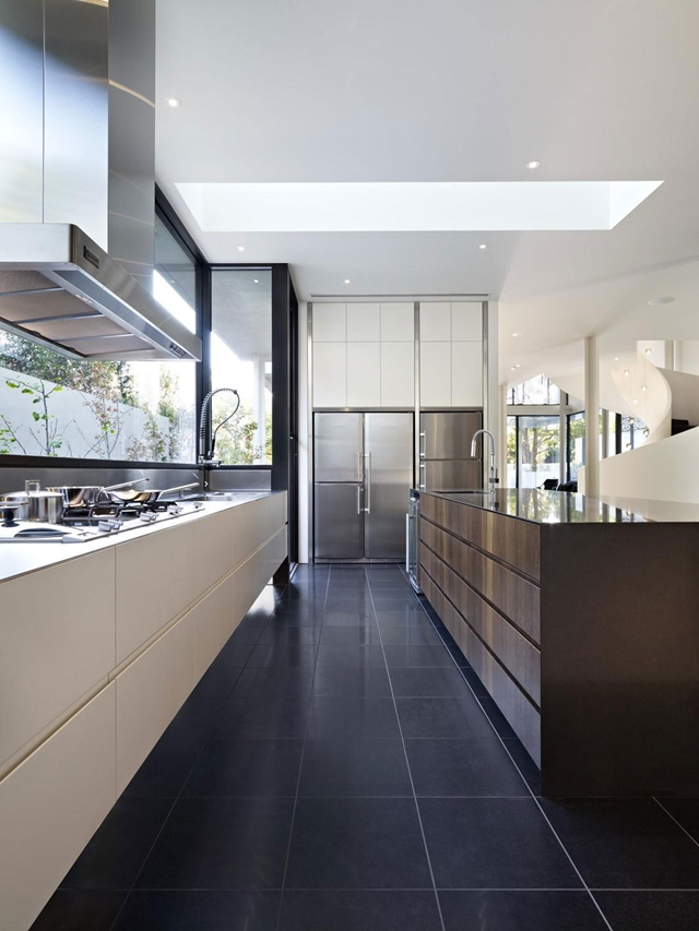 Contemporary kitchen with dark and bright furniture