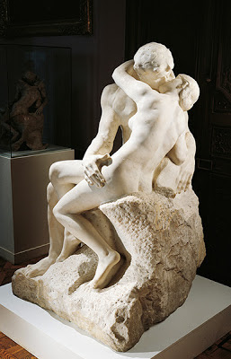 sculpture of man and woman kissing