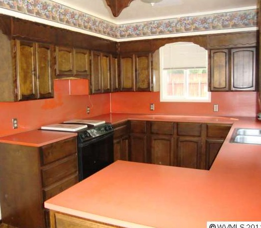 The Kitchen Had Orange (like Orange Orange) Countertops And Backsplash, All  Of The Light Fixtures Were Fabulous 70u0027s Finds, There Were Super Dark Wood  ...