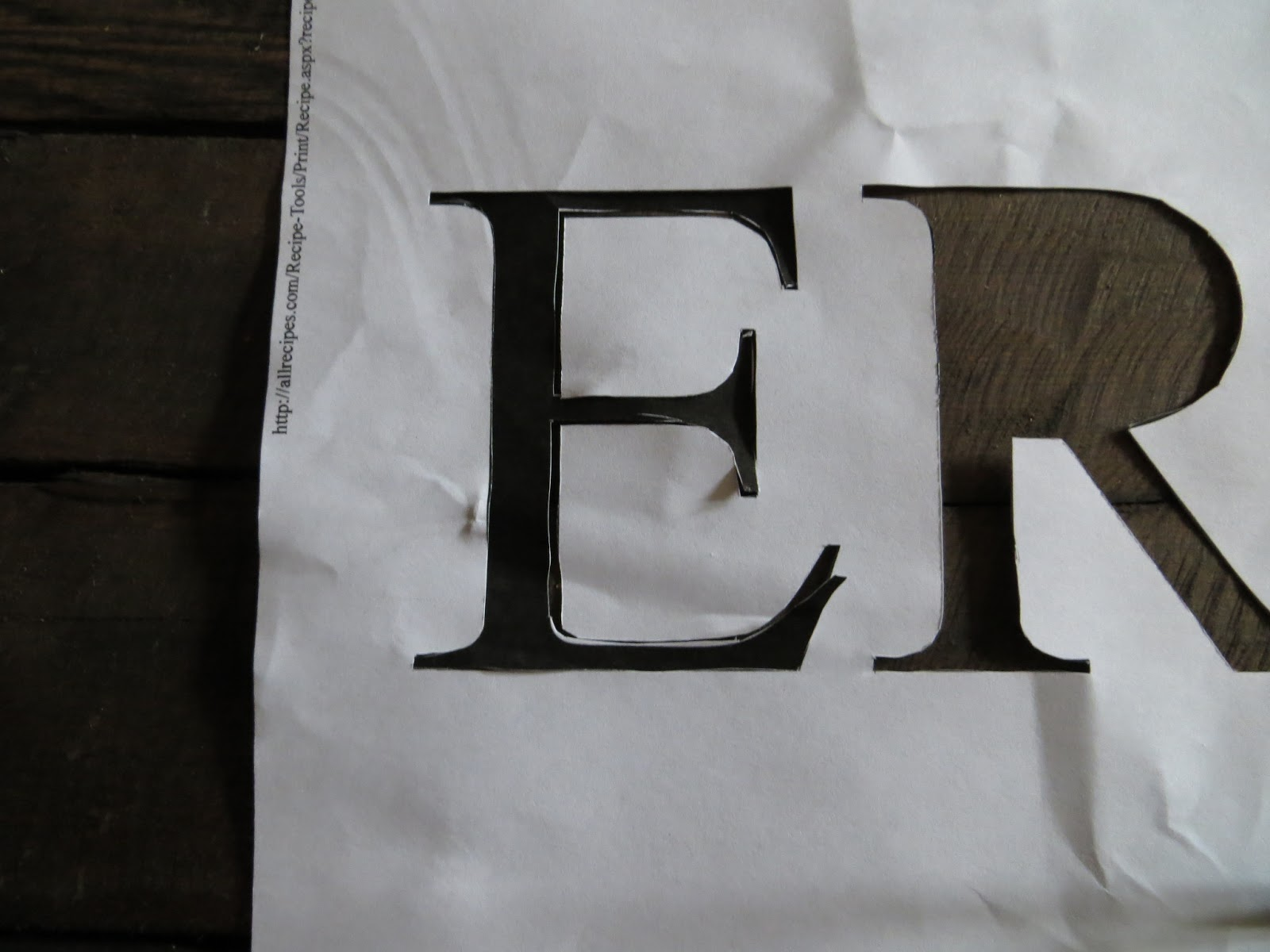 the other method is this you place the stencil over the cut out letters and remove the black letter after that trace the empty letter onto the wood
