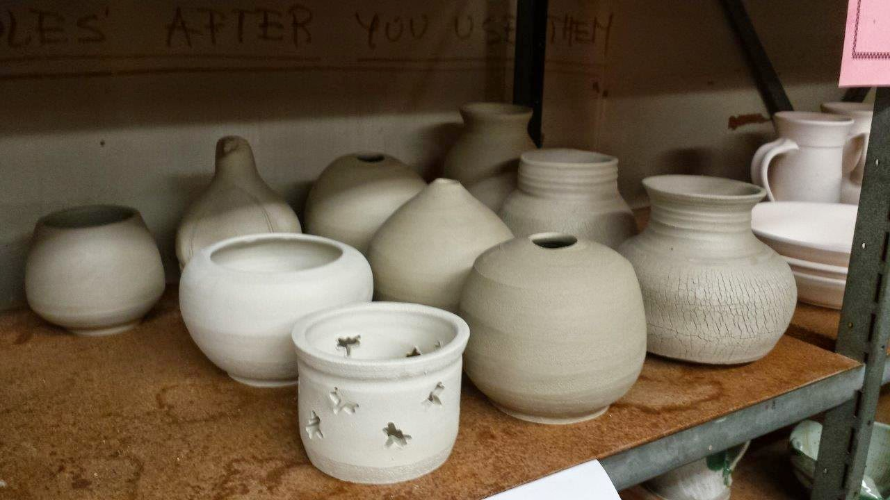 Pottery drying in preparation for raku firing.