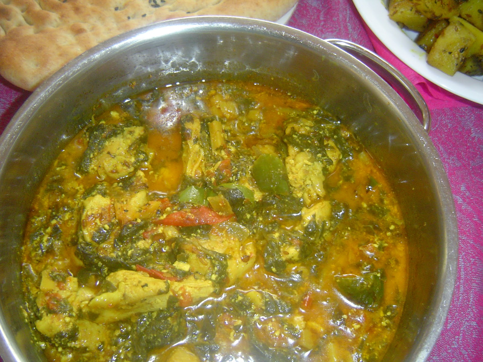 pakistani home cooking chicken and spinach in coconut