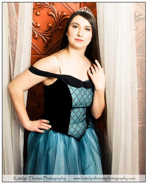 High school dancer wearing a blue and black princess costume