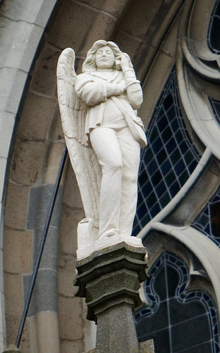 'HALO ANGEL:'. The statue of an angel outside St. John the Evangelist Cathedral in 's Hertogenbosch, the Netherlands, holds a cellphone, which has two numbers.