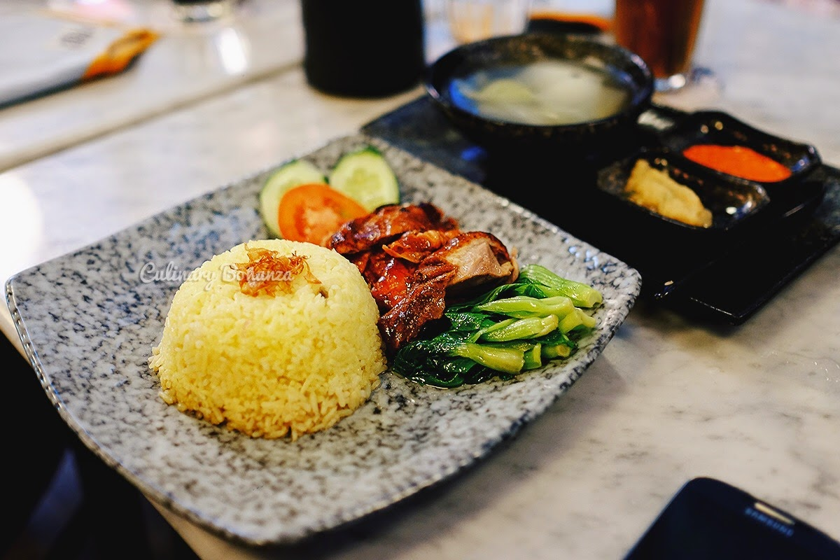 Hainanese Chicken Rice served with fragrant yellow rice