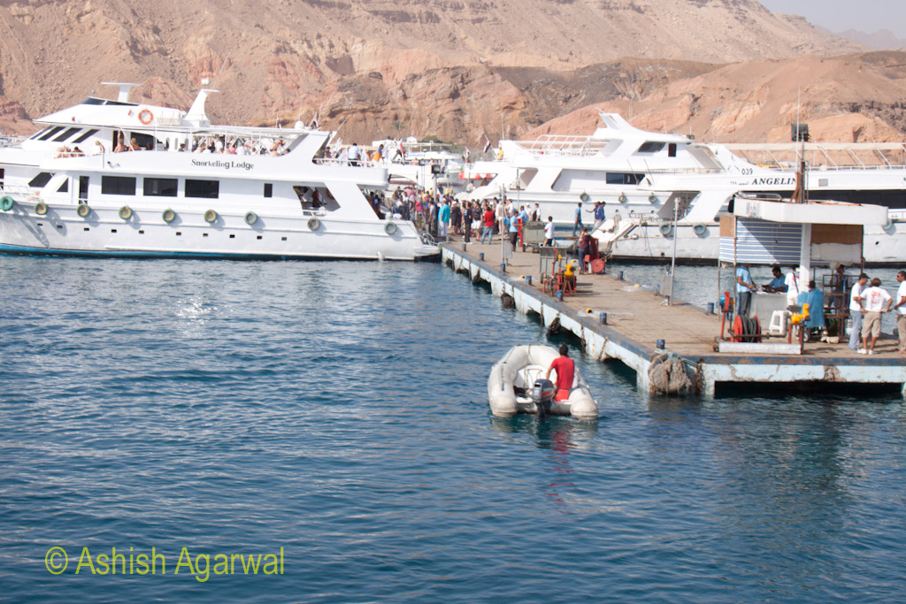 The pier at the Sharm el-Sheikh where people are boarding a ship bound for snorkeling