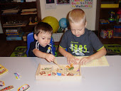 July 2011 - My grandson and my nephew working on a puzzle together.