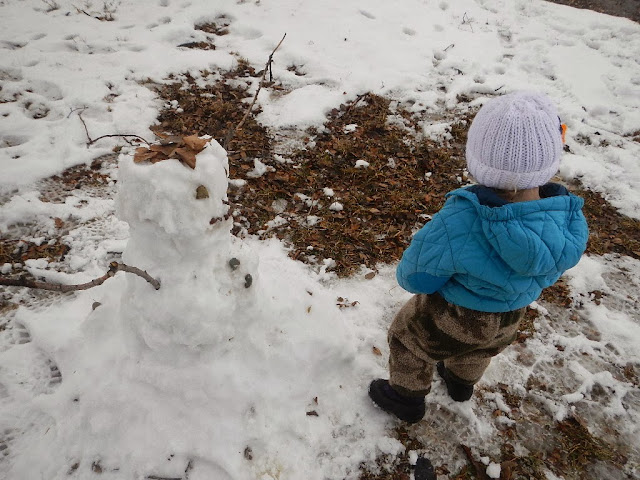 toddler building first snowman montana