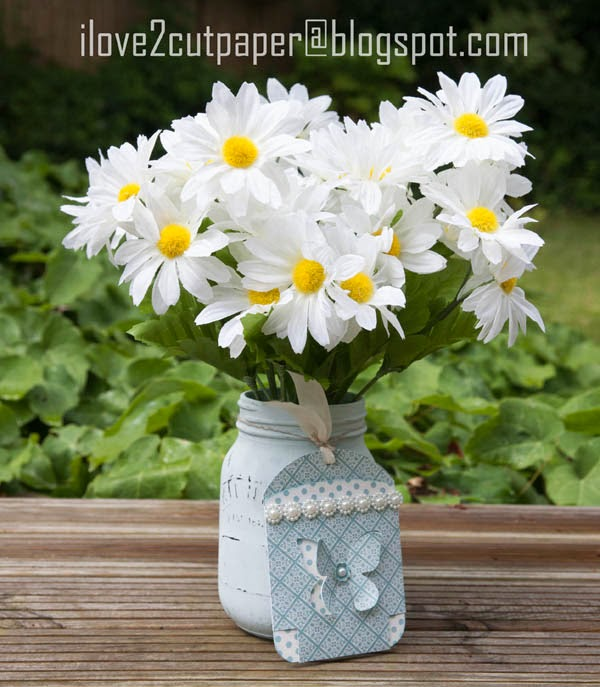 Painted jar with butterfly tag