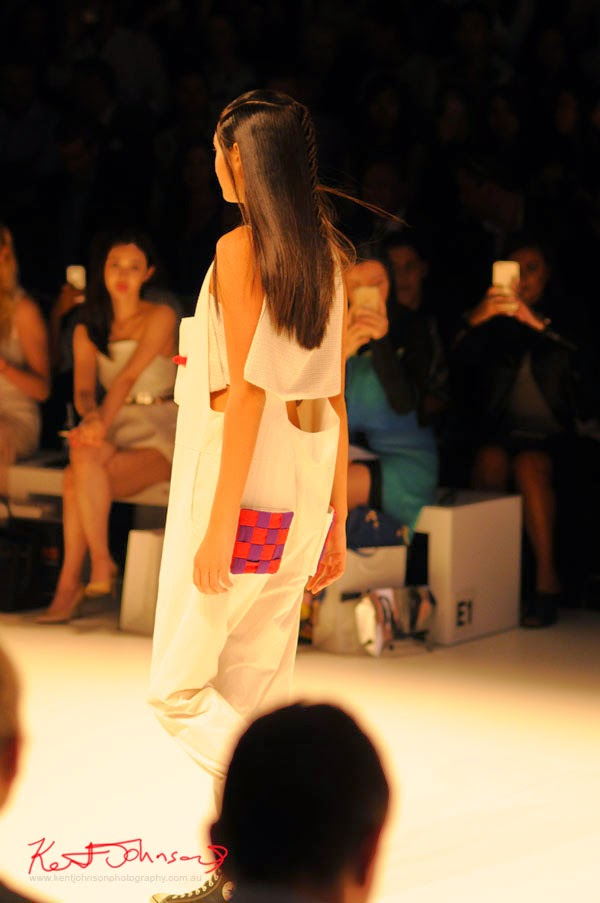Back view, white jumpsuit with relief red/purple check panel box with door!! Matiny Ng's 580 fashion label at MBFWA Raffles International Showcase, Carriageworks Sydney. Photographed by Kent Johnson.