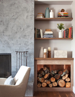 walnut shelvings containing books, accessories and logs for the marin fireplace