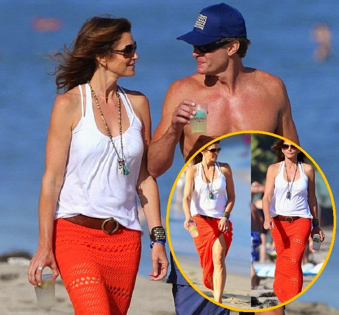 If this is 48, then the middle life doesn't look bad to us as Cindy Crawford seemed to enjoyed the sand between her great point of beach fashion in Malibu, CA, USA on Friday, July 4, 2014.