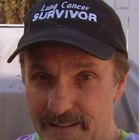 lung cancer survivor wearing a baseball style hat emblazoned with lung cancer survivor