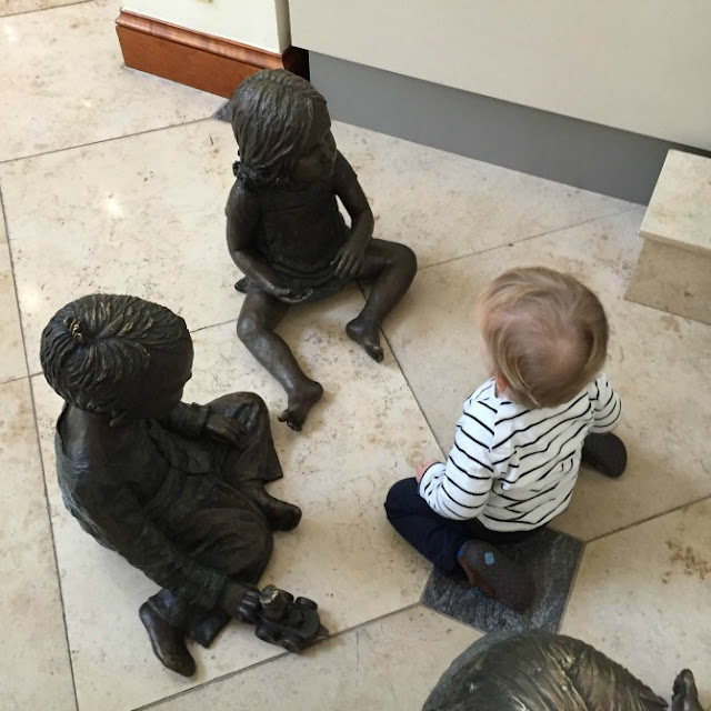 Squidge playing with bronze children