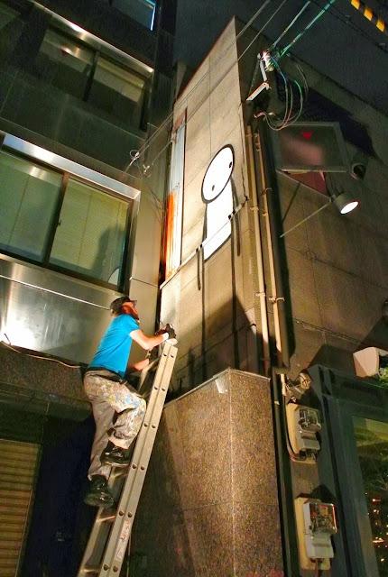 British Street Artist Stik paints a new street piece on the streets of Osaka, Japan. 4