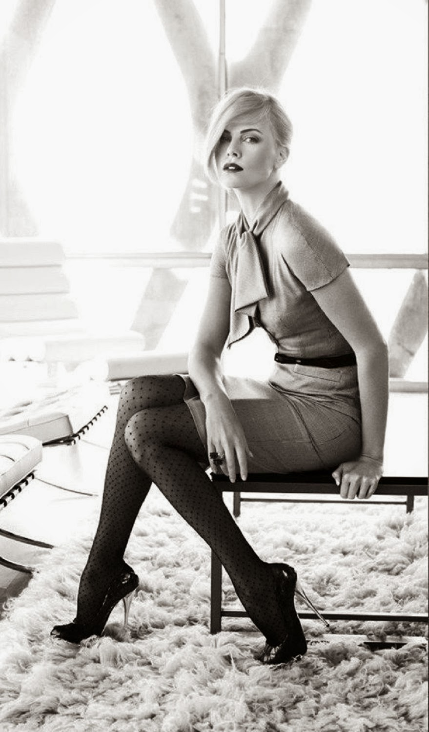 Charlize Theron in stockings and heels