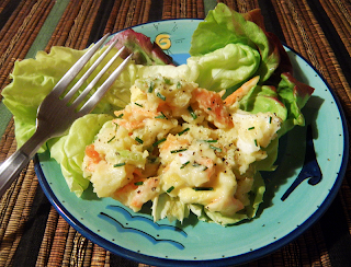 Plate of Potato Salad on Red Leaf Lettuce