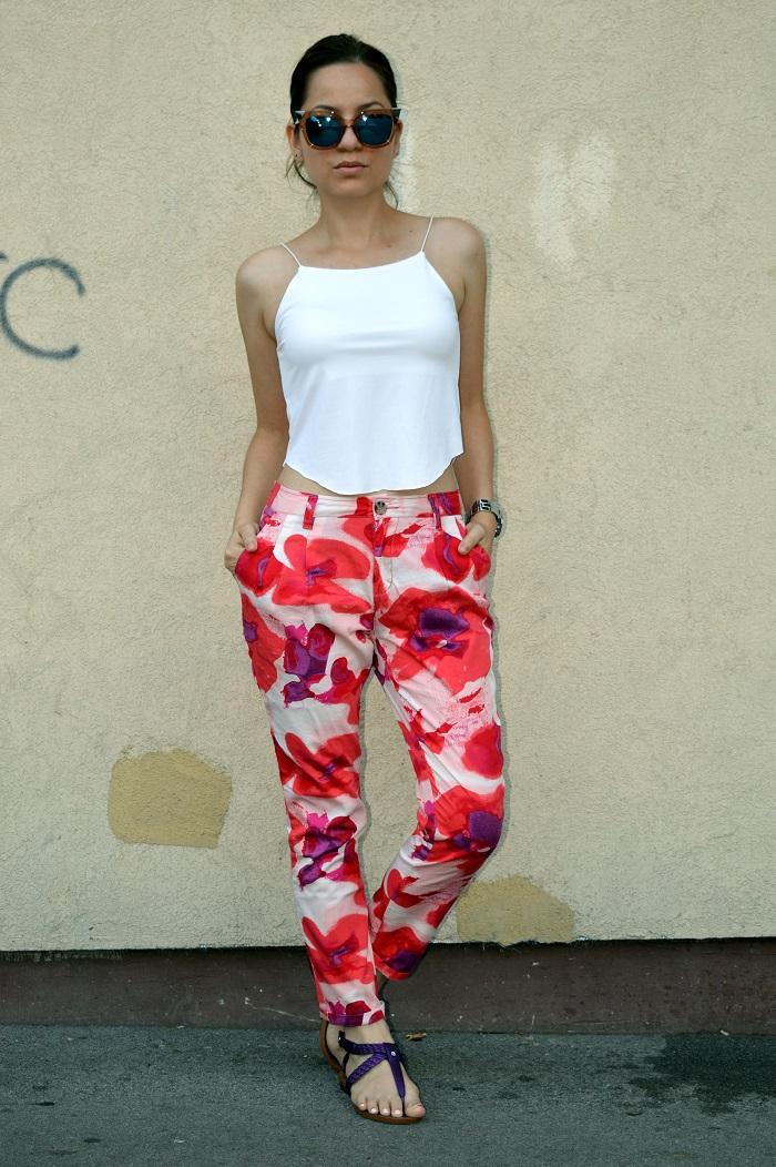 outfit, white crop top, blue mirrored cat eye sunglasses, floral pants, purple flip flops flat sandals, michael kors watch