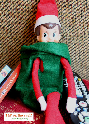 Ideas for Christmas Fun with your Elf-on-the-Shelf. Watching his favorite Christmas movies in an elf snuggie.