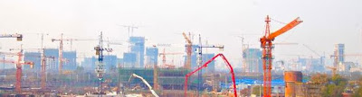 color photo of construction cranes in Shanghai, China