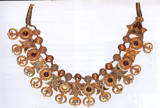 Necklace, Taxila, 1st cent. AD  A necklace of remarkable charm in Greco-Roman style, it has gold set with turquoise and garnets. The pendants feature the famed filigree work of Taxila, and its equally famed granulation.