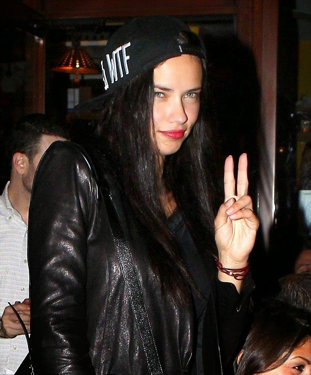 With her dark color clinging geometric mini dress, Adriana Lima cut a striking sight as stepped out at Da Salvino restaurant in New York City on Thursday, August 31, 2014.