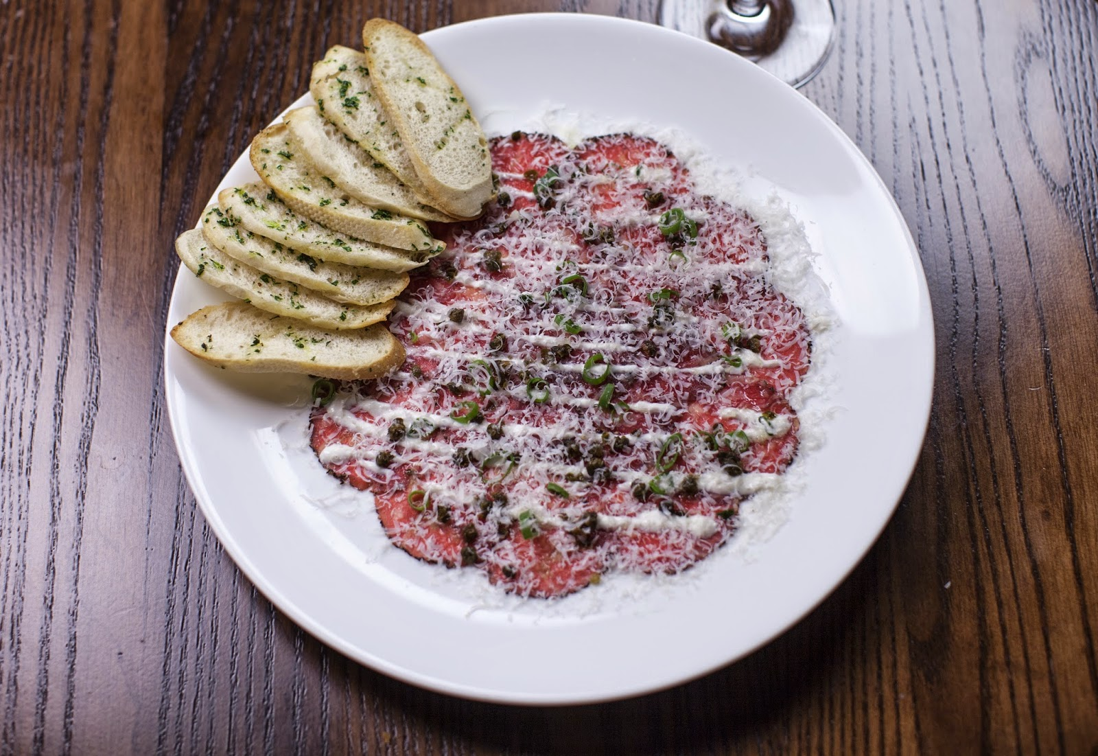 American Kobe Beef Carpaccio: Fried Capers, Scallions, Mustard Oil, Creamy Horseradish, Shaved Reggiano Parmesan