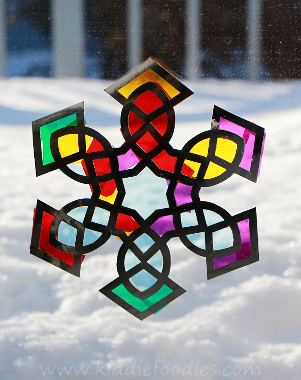 http://www.kiddiefoodies.com/crafts/suncatcher-snowflake-craft-for-kids