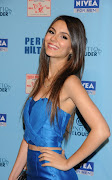 This is Victoria Justice. She has got long brown hair.