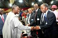 Pres.Jonathan shaking Prof. Osinbajo at camp