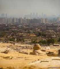 The Sphinx looking at Cairo