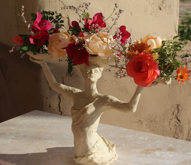 sculpture, art, woman, lady, sarah myers, flowers, bouquet, arrangement, roses, figure, figurative, stoneware, ceramic, happy, beautiful, graceful, half-length, escultura, arte, flores, decor, decorative, centerpiece, centrepiece, vase, face, classical, human, horizontal, lavish, bougainvillea, chrysanthemums