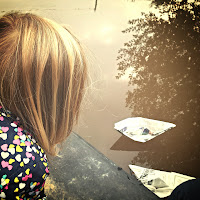 Watching the paper boats sail away
