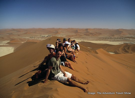 adventurers on a sand dune Show Director gives lowdown on Adventure Travel Show