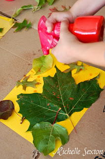Spraying paint onto leaves and paper