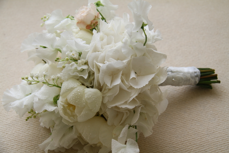 An Exceptional Wedding Bouquet In Soft Dreamy Shades Including Fragrant  Lily Of The Valley, Bomabstic Roses, White Peonies And Sweet Peas
