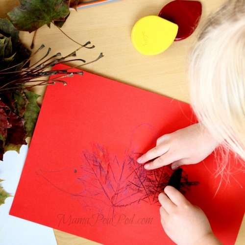 child making hedgehog art from leaf rubbings