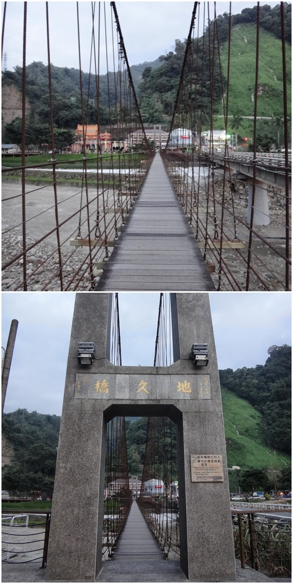 Taking the challenge to cross a suspension bridge in the village nearby the scenic area of Sun Moon Lake in Taiwan