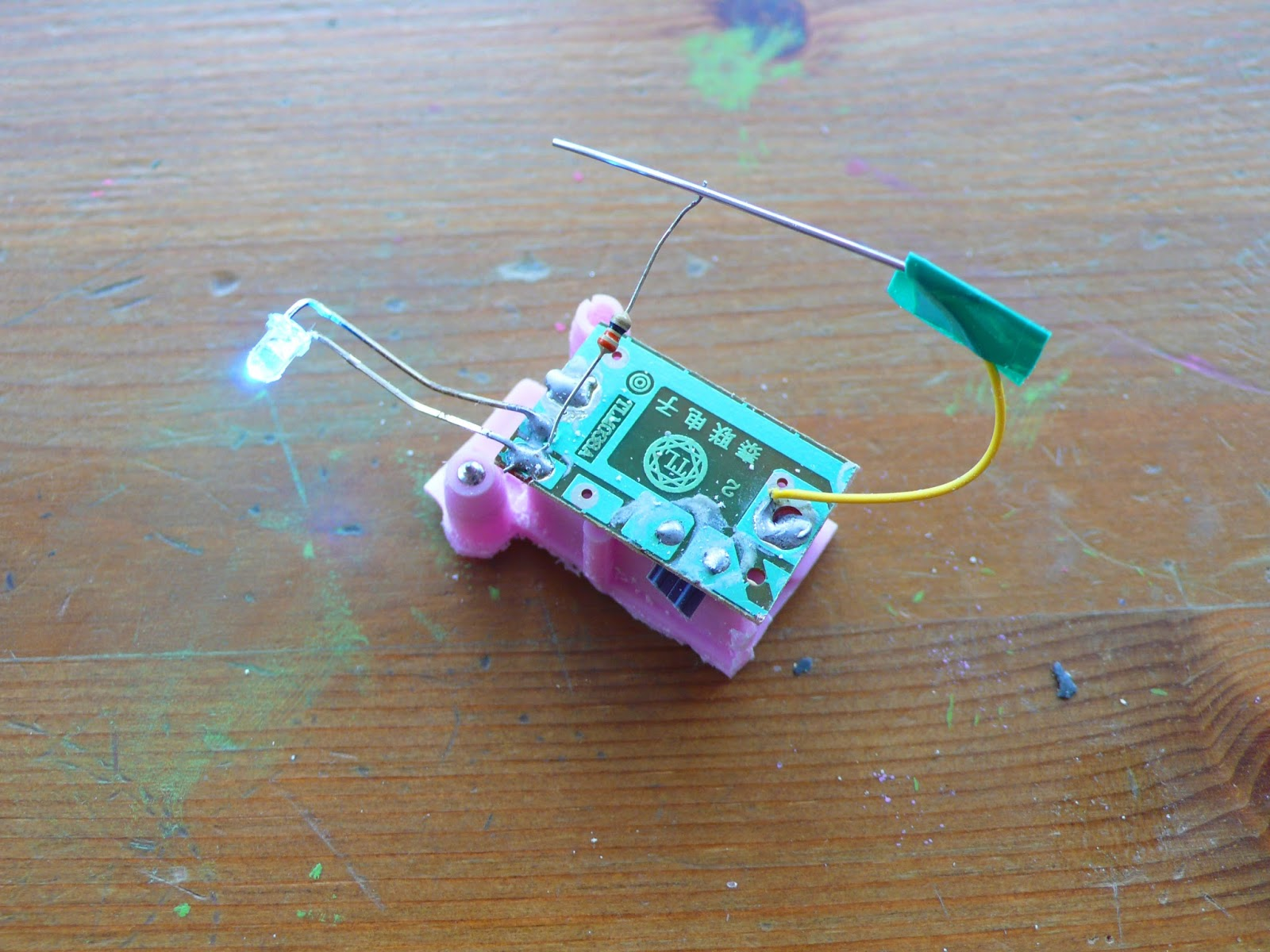A hacked childs toy which has been sawn down to remove the unnecessary parts.