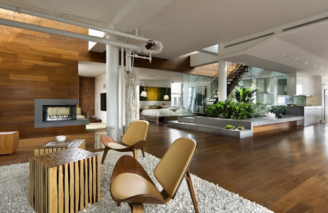 Photo of amazing interiors in the penthouse, fresh design and wooden furniture