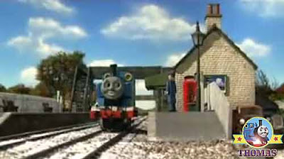 Thomas the number one engine stopped opposite the small airfield branch line Dryaw station master